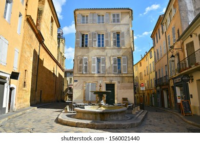 May 15, 2019. Panoramic view of the Place Séraphin Gilly water fountain and the surrounding old traditional buildings in the historic center of Aix-en-Provence, Provence-Alpes-Côte d'Azur, France.