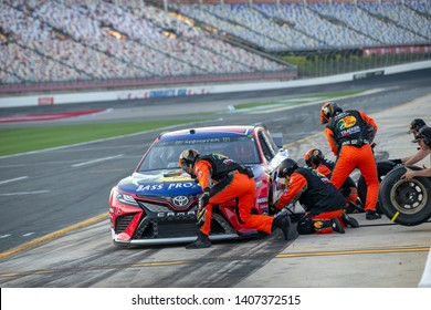 May 17, 2019 - Concord, North Carolina, USA: Martin Truex Jr. (19) and crew takes to the track to perform a pitstop to qualify for the Monster Energy All-Star Race at Charlotte Motor Speedway