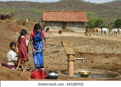 May 17th 2010 Dindori District Madhya Pradesh India Baiga tribal woman fetching potable  Borewell drinking water in a village