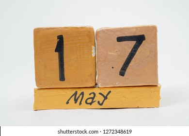may 17th. Day 17 of month, handmade wood calendar isolated on white background. Spring month, day of the year concept.