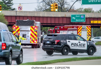 May 18 2018 Stevensville MI USA; a police man directs traffic at the scene of a bad accident on the highway