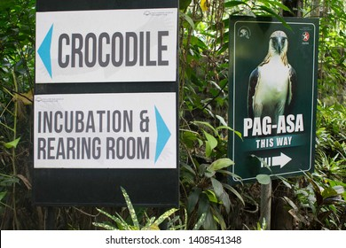 May 18, 2019- Davao Philippines : A sign points to the crocodile and the philippine eagle in Davao Philippines. Arrow pointing to the philippine eagle for tourist.