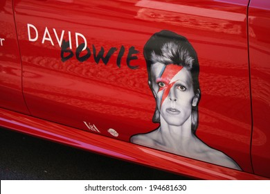 "MAY 19, 2014 - BERLIN: advertisement on a car - impressions from the ""David Bowie"" exhibition in the Martin Gropius-Bau, Berlin-Tiergarten."