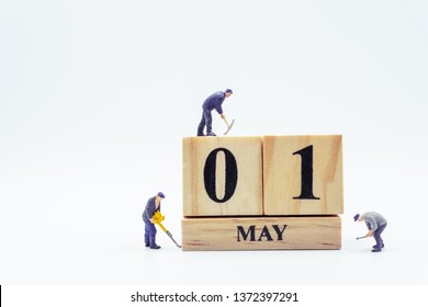 May 1st. Day 1 of month.  Miniature worker wooden block  calendar. labor day's concept.