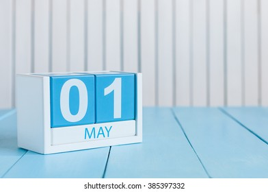May 1st. Image of may 1 wooden color calendar on white background.  Spring day, empty space for text.  International Workers' Day