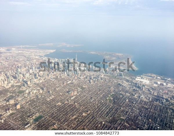 MAY 2, 2018 - TORONTO, ONTARIO, CANADA: AERIAL SHOT OF TORONTO WITH CN TOWER, DOWNTOWN AND LAKE ONTARIO.