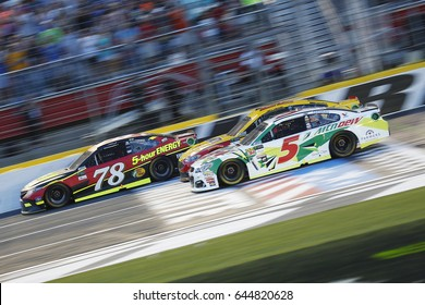 May 20, 2017 - Concord, NC, USA: Martin Truex Jr. (78), Joey Logano (22) and Kasey Kahne (5) battle for position at Charlotte Motor Speedway in Concord, NC.