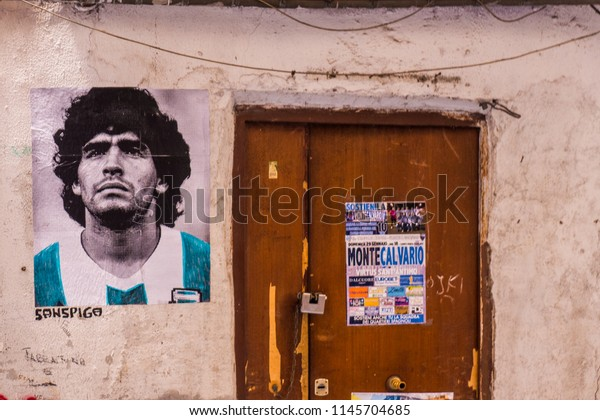 «Naples, Italy» May 20, 2017: A stencil fan art about Diego Maradona in his Argentinian national team t-shirt during the 86 world cup.