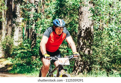 MAY 20, 2018 ,Maloy Stakhovo, Minsk region Borisov district Stakhov Bicycle Marathon 2018, Borisov A man riding a bicycle in the forest