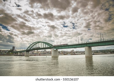 MAY 2016, BELGRADE SERBIA: Old rail Sava bridge, connecting two Belgrade shores divided by river Sava. Bright sunny day with rich clouds.