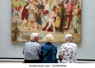MAY 2016 - BERLIN: art in a museum: visitors look at a painting, Alte Nationalgalerie.