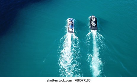 May 2017: Aerial drone bird's eye view photo of jet ski speeding in port of Mykonos island, Cyclades, Greece