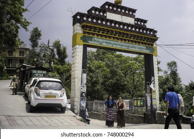 May 2017, Dharamsala, India, McLeod Ganj,the gate over the road leading to many Tibetan Government in Exile buildings, two women in traditional Tibetan clothing