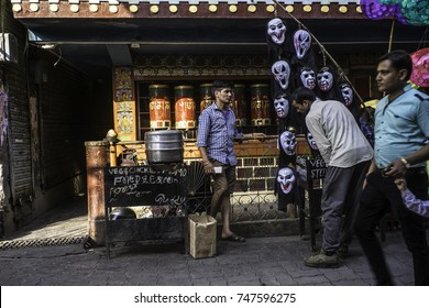 May 2017, Dharamsala, McLeod Ganj, Himalayas,in front of the Tibetan temple in the main village locals sell steamed momo (dumplings), and Halloween masks