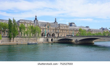 May 2017: Photo from iconic Palace of Louvre with beautiful scattered clouds, Paris, France