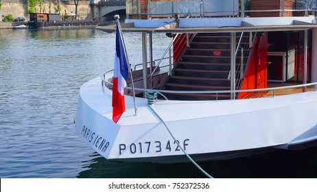 May 2017: Photo of tradtional boats docked in river Seine, Paris, France