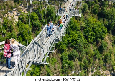 May 2017, Skypark bungee jumping, Sochi, Russia. Happy people at the hanging bridge