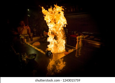 May, 2018 - Ari Atoll, Maldives: A teppanyaki chef cooking at teppan in a Japanese steakhouse on Mishi Sushi. Gorumet food in luxury restaurant