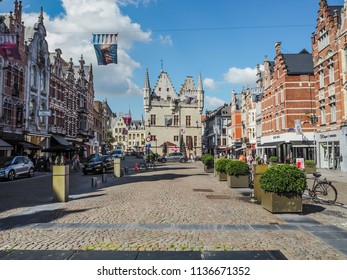 May 2018 - Mechelen, Belgium: The Ijzerenleen, one of Mechelen's main shopping streets in the city center, with in the back the Aldermen's house
