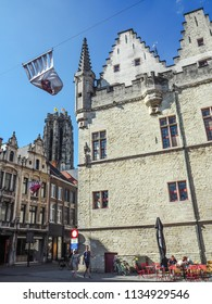 May 2018 - Mechelen, Belgium: The thirteent century Aldermen's house and the St. Rumbolds cathedral in the city center of Mechelen
