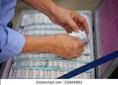 May ,2018 : unidentified man buying thai lottery at market , Bangkok,Thailand
