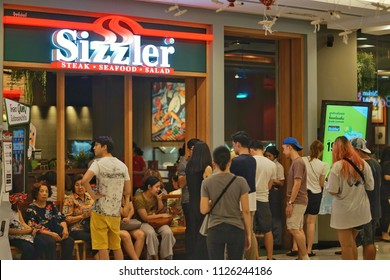 May ,2018 : unidentified people waiting for eat at Sizzler restaurant  ,central store, Bangkok,Thailand
