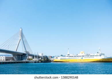 May 2019 - Aomori,JAPAN: Aomori Bay Bridge and Hakkoda Maru, ship that carried trains from Aomori, in the north of Honshu Island, to Hakodate, Hokkaido from 1966-1988.Now it is permanently docked.