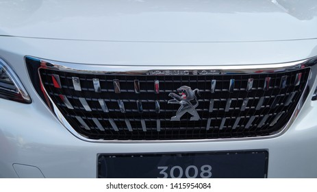 May 2019 Bautzen Saxony Germany. Front picture of Peugeot car, closeup on logo and grill of white auto