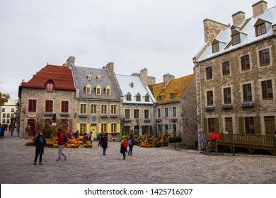 May 2019. Quartier du Petit Champlain, neighbourhood of Old Quebec (Canada). Beautiful typical street. Square busy with few tourists. Oldest commercial district in North America. European style.