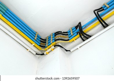 May 2019 in Rayong City, Thailand. Electrical system and storing electrical wires coming out of the PVC pipe into an PVC box that is used to store electrical wiring, especially for safety purposes.