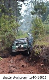 May 21, 2017. Bandung, West Java, Indonesia. Old Classic 4x4 Landrover Series Offroading Jungle Forest at Lembang, West Java, Indonesia
