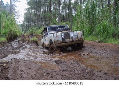 May 21, 2017. Bandung, West Java, Indonesia. Old Classic 4x4 Landrover Series Offroading in the Mud Way at Lembang, West Java, Indonesia