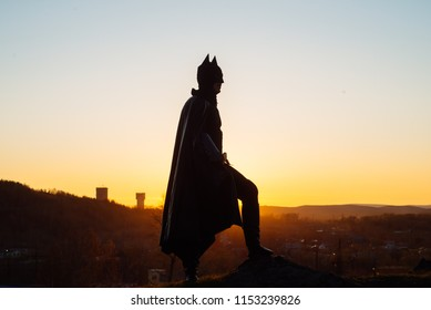 May 21, 2018, Russia Nizhny Tagil: Batman cosplay-photo shoot in a suit and black cloak, at sunset over the city
