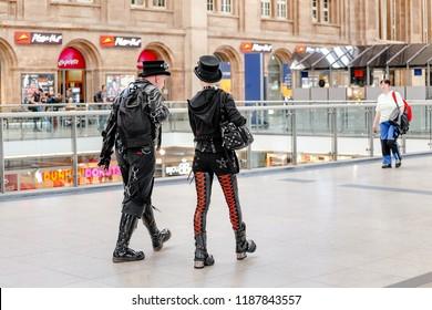 MAY 21, LEIPZIG, GERMANY: Heavy Metal guys fans, metalheads walk at the railway station. Gothic Leipzig annual festival