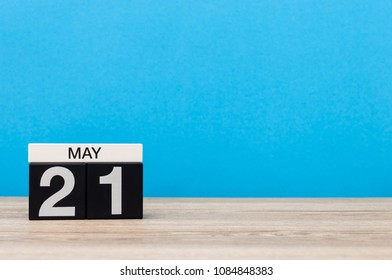 May 21st. Day 21 of month, calendar on blue background. Spring time, empty space for text