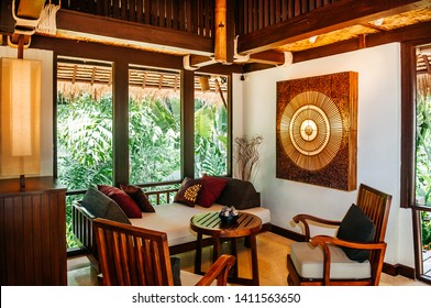 MAY 22, 2014 Krabi, THAILAND - Asian luxury style hotel living room with contemporary wooden furnitures, chairs, tables , pillows and Thai style wall decoration