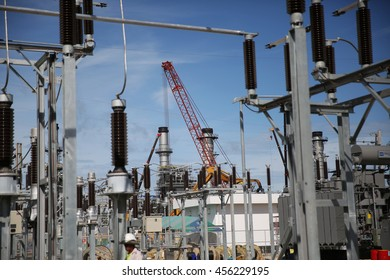 MAY 22, 2015: SRIRACHA - THAILAND. View of new construction of electrical power switch-gear and power plant in area of oil refinery plant on bright blue sky and a sunny day.