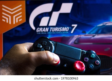 May 22, 2021, Brazil. In this photo illustration the controller for PlayStation (PS) and in the background the game logo Gran Turismo 7