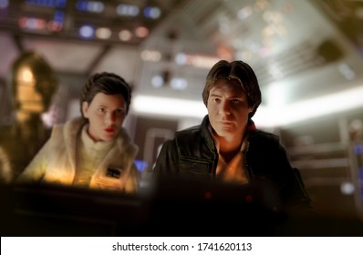 MAY 23 2020: Recreation of a scene from Star Wars The Empire Strikes Back where Han Solo tries to escape the Empire with Princess Leia Organa and driod C-3PO - Hasbro action figures