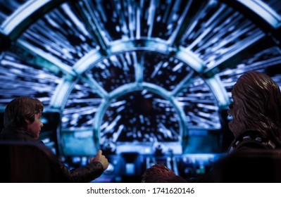 MAY 23 2020: scene from Star Wars - Corellian freighter Millenium Falcon travels through Hyperspace - Kessel Run - Hasbro action figures