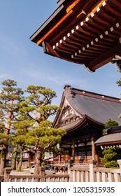 MAY 26, 2013 Gifu, JAPAN - Old historic ancient wooden main hall Honko-Ji temple  of Hida Furukawa old town.  Under Evening light and blue sky