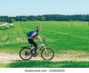 May 26-27, 2018 Naliboki,Belarus All-Belarusian amateur marathon Naliboki A girl is riding a bicycle on the road