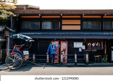 MAY 27, 2013 Takayama ,Gifu, Japan - Old vintage Sanmachi Suji old Edo district of Takayama with Japanese pulled rickshaw and old wood house, famous Takayama old town.