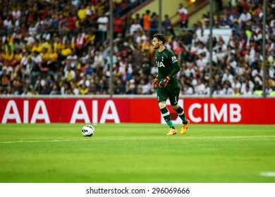 May 27, 2015- Shah Alam, Malaysia: Tottenham Hotspur's goalkeeper Hugo Lloris prepares to clear the ball in a friendly game against Malaysia. Tottenham Hotspur is on a Asia-Australia tour.