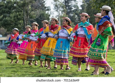 May 27, 2017 Sangolqui, Ecuador: indigenous quechua women in colourful traditional dress dancing outdoors at a rural rodeo opening