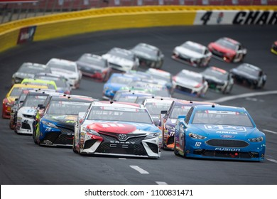 May 27, 2018 - Concord, North Carolina, USA: Kyle Busch (18) races down the front stretch during the Coca-Cola 600 at Charlotte Motor Speedway in Concord, North Carolina.