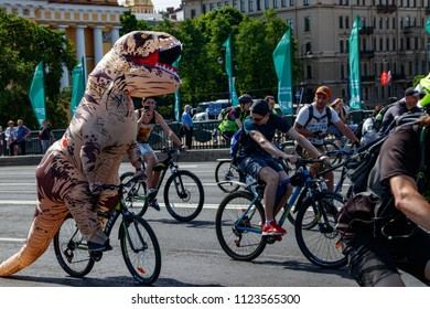 May 27, 2018, St. Petersburg, Russia: The cyclist in the Godzilla costume in the parade of bikes.