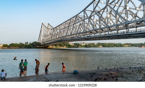 May 27,2018. Kolkata,India. People doing Morning activities on the Bank of Hooghly River overlooking The Howrah Bridge .