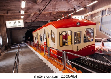 MAY 28, 2013 Toyama, Japan - Tunnel with Kurobe Cable Car running between Kurobe Dam and Kurobedaira, only underground cable car in Japan