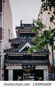 MAY 29, 2013 Matsumoto, JAPAN - Old Japanese Edo architecture building with ceramic tiles roof - castle style building became bookstore in Nawate street area.